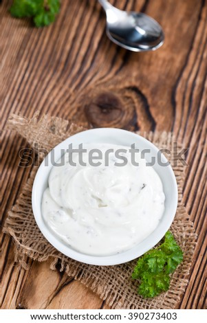 Fresh made Sour Cream (selective focus) on vintage wooden background