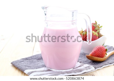 Fresh made Strawberry Milk on an old wooden table