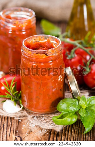 Fresh made Tomato Sauce (homemade) with basil, garlic and salt - stock photo