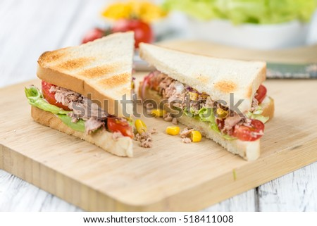 Fresh made Tuna Sandwiches (detailed close-up shot; selective focus)