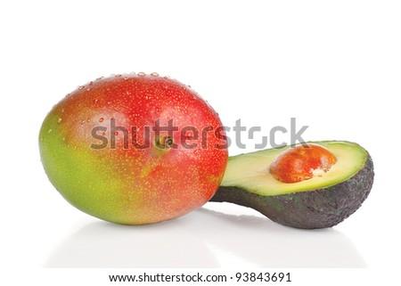 Fresh mango and half of avocado on a white background - stock photo