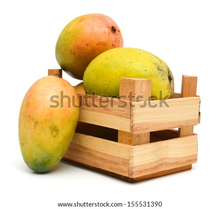 fresh mango fruit in a wooden box on a white background  - stock photo