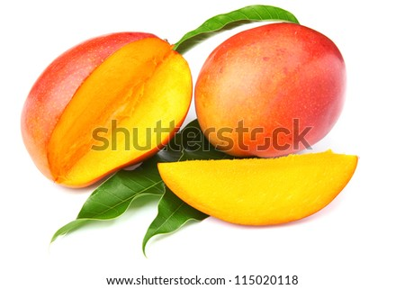 fresh mango fruit with cut and real mango leafs isolated on white background