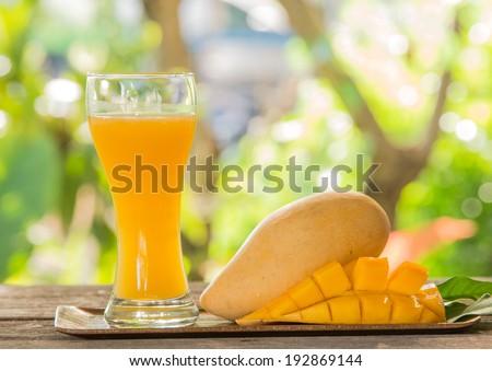 Fresh mango juice and mango fruit - stock photo