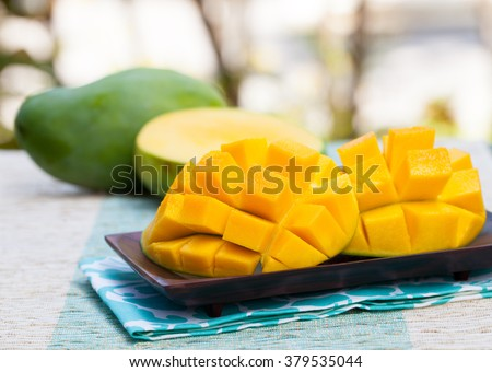 Fresh mango organic product on a tropical outdoor background - stock photo