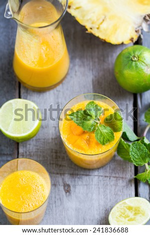 Fresh Mango with Pineapple and Lime smoothie - stock photo