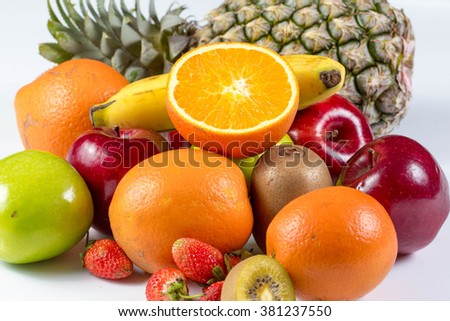 Fresh many fruits, orange, apple, pineapple banana and kiwi on white background