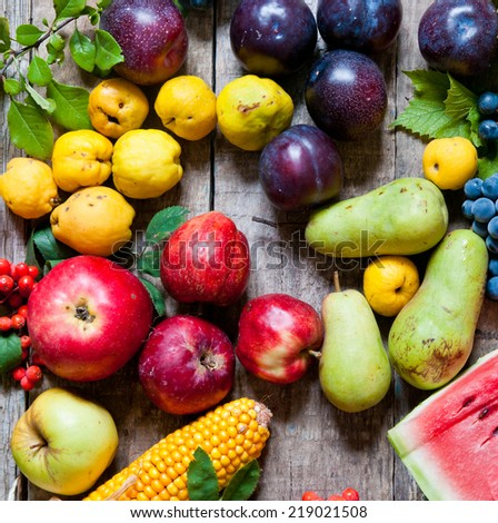 Fresh market fruit on a wooden background