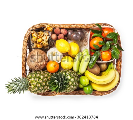 Fresh market fruits on wicker tray. Healthy eating and dieting concept. Single object isolated on white background clipping path included. Top view - stock photo