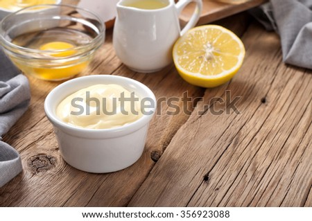 Fresh mayonnaise with ingredients for cooking homemade mayonnaise closeup - stock photo