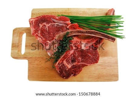 fresh meat : raw beef spare ribs with thyme and green chives on wooden board isolated over white background - stock photo