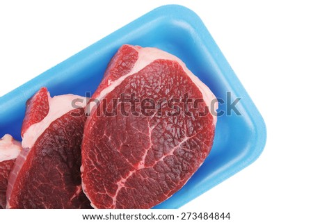 fresh meat : raw uncooked fat lamb pork fillet mignon loin on blue tray isolated over white background - stock photo