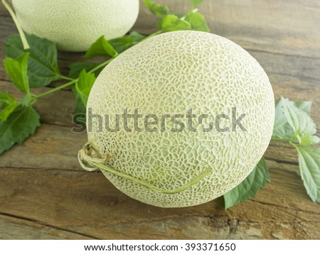 Fresh melon on a rustic wooden background. - stock photo