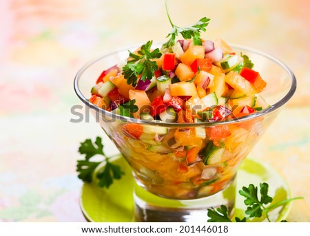 Fresh melon salsa with red pepper and cucumber - stock photo
