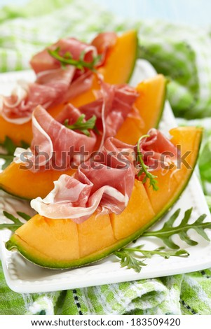 Fresh Melon with Prosciutto - stock photo