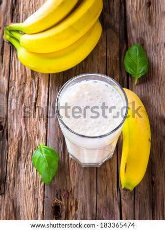 Fresh milk, banana drink on wodeen table, assorted protein cocktail with fruits. - stock photo