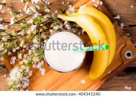 Fresh milk, banana drink on wooden table, assorted protein cocktail with fresh fruits.  - stock photo