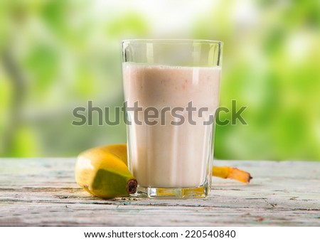 Fresh milk, banana drink on wooden table, assorted protein cocktails with fresh fruits.  - stock photo