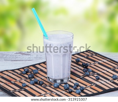 Fresh milk, blueberry drink on wooden table, assorted protein cocktails with fresh fruits.