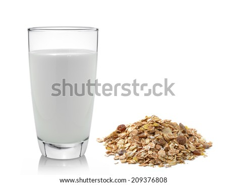 fresh milk in the glass and muesli breakfast placed on white background - stock photo