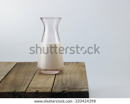 Fresh Milk on Glasses Bottle, Dairy Produce Concept of Breakfast on Wood Table - stock photo