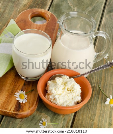 Fresh milk  products on a wooden table. Selective focus - stock photo