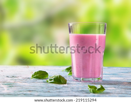 Fresh milk, raspberry drink on wooden table, assorted protein cocktails with fresh fruits.  - stock photo