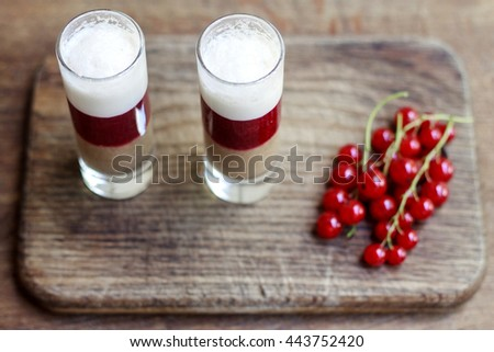 Fresh milk, strawberry, blueberry and banana drinks on wodeen table, assorted protein cocktails with fresh fruits. - stock photo
