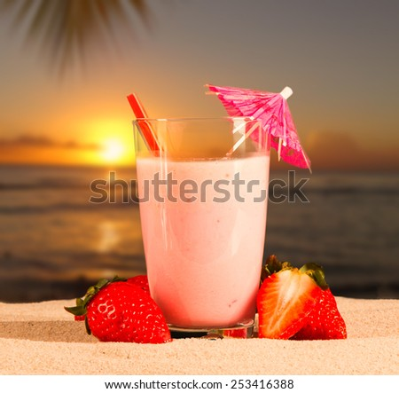 Fresh milk, strawberry drink on sand, assorted protein cocktail with fresh fruits and tropical beach background  - stock photo