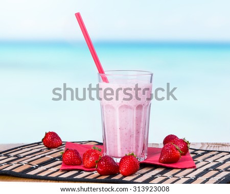 Fresh milk,strawberry drink on wooden table, assorted protein cocktails with fresh fruits.  - stock photo