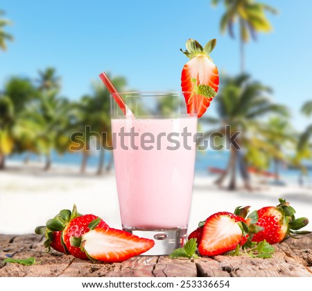 Fresh milk, strawberry  drink on wooden table, assorted protein cocktails with fresh fruits and tropical beach.  - stock photo