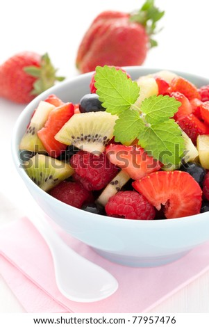 fresh mixed fruit salad with mint - stock photo