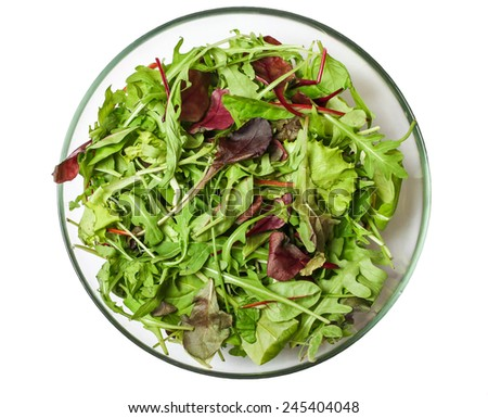 Fresh mixed salad greens in serving bowl isolated on white background - stock photo