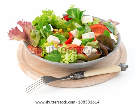 Fresh mixed salad with tomatoes, corn and feta cheese
