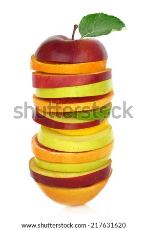 Fresh mixed slices of fruit in a row - stock photo