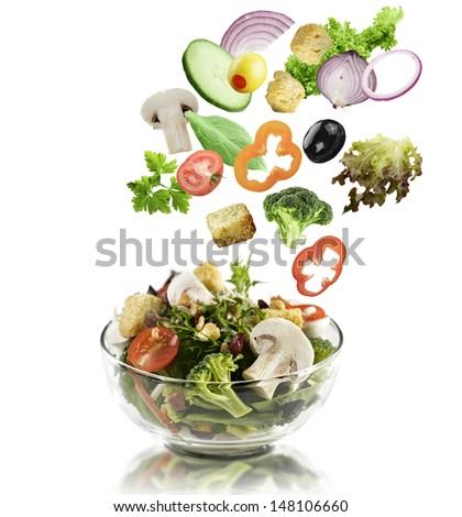 Fresh Mixed Vegetables Falling Into A  Salad Bowl - stock photo