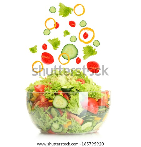 Fresh mixed vegetables falling into bowl of salad isolated on white - stock photo