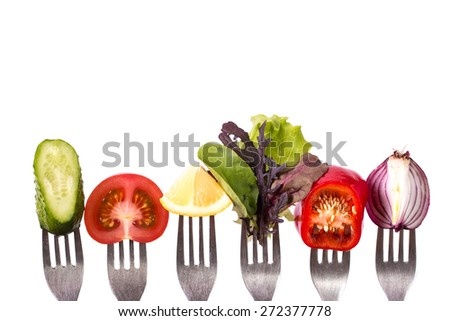 Fresh mixed vegetables on fork   - stock photo