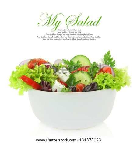 Fresh mixed vegetables salad in a bowl. Isolate on white