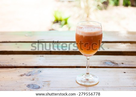 Fresh mixture vegetable and fruit juices on wood table - stock photo