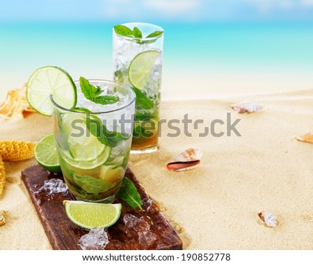 Fresh mojito drink on beach - stock photo