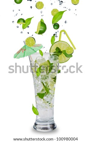 Fresh mojito drink with falling limes into glass. Isolated on white background - stock photo