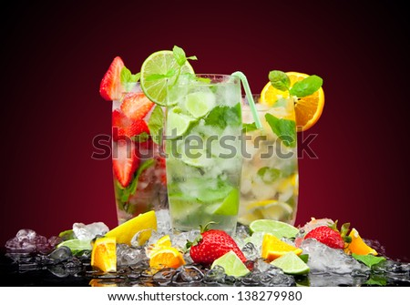 Fresh mojito drink with ice and fruit - stock photo