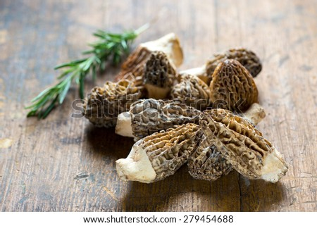 Fresh Morelle Mushrooms on rustic background - stock photo