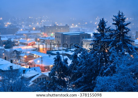 Fresh morning snow over Appalachian Mountain city - stock photo