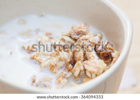 fresh muesli with a mix of milk, oats and bran with dried fruit and nuts
