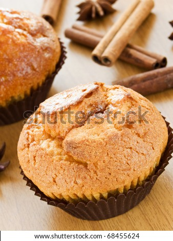 Fresh muffins on wooden background. Shallow dof.