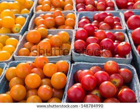 Fresh multicolored cherry tomatoes at local farm market. - stock photo