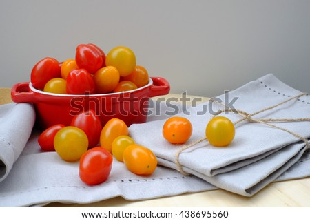 Fresh multicolored cherry tomatoes in the bowl.