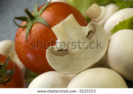 Fresh mushroom close up with tomato in background